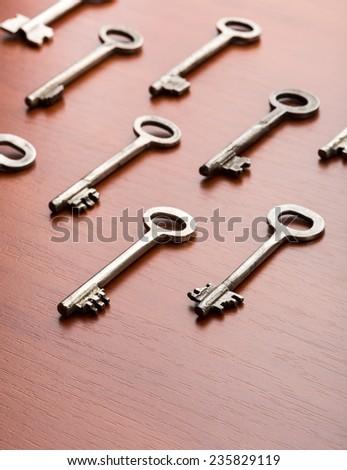 Keys on the wood table - stock photo