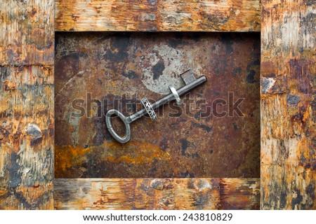 Keys on wooden background - stock photo