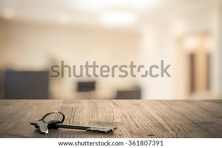 keys on wooden table in the living room - stock photo