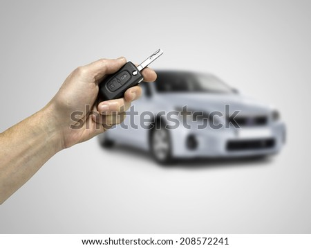 Keys to the car. grey gradient background. - stock photo