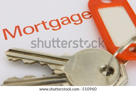 Keys with a paper with the word mortgage on it, max depth of field. - stock photo