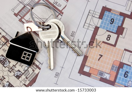 Keys with home on blueprints - stock photo