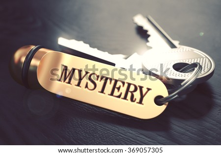 Keys with Word Mystery on Golden Label over Black Wooden Background. Closeup View, Selective Focus, 3D Render. Toned Image. - stock photo