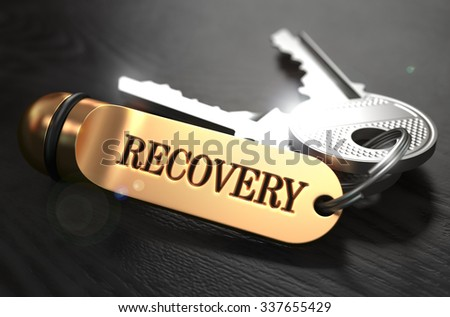 Keys with Word Recovery  on Golden Label over Black Wooden Background. Closeup View, Selective Focus, 3D Render. - stock photo