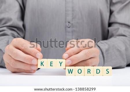 Keywords concept. Man complete word keywords.  - stock photo