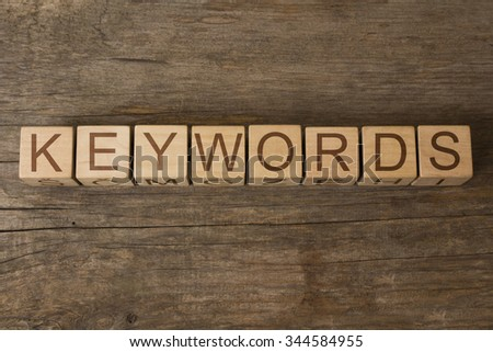 KEYWORDS text on a wooden background - stock photo