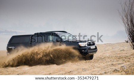 KHABAROVSK, RUSSIA - october 30, 2014: Black Toyota  Tacoma quick ride on a offroad