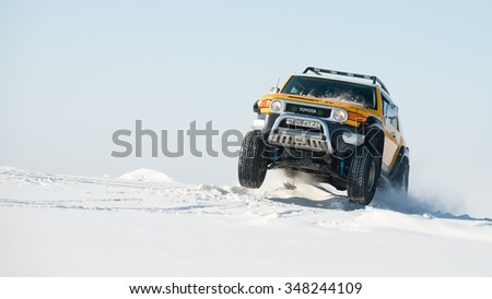 Khabarovsk, Russia - October 9, 2013: Toyota FJ cruiser goes fast on a snowy field