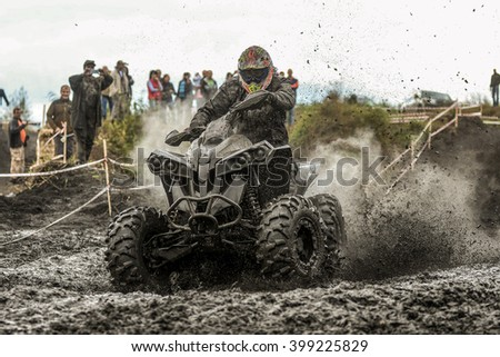 "Khabarovsk, Russia - September 12. 2015 : unidentified rider in action on stage Enduro Khabarovsk ""Drive trophy 2015"" ATVs in the mud with a big splash"