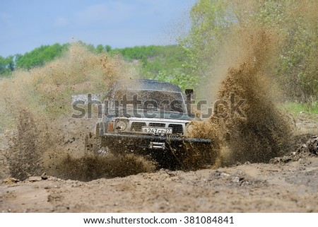 "Khabarovsk, Russian - May 25, 2013 : carsNissan Safari moving on the off road at competitions ""Tank storm 2013"""