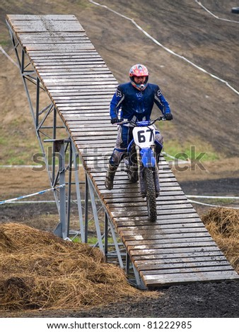 """KHABAROVSK RUSSIAN - MAY 21: Dmitry Fyodorov in action at the first stage of the Khabarovsk enduro """"KHABARIGENS 2011 May 21, 2011 in Khabarovsk, Russia - stock photo"""
