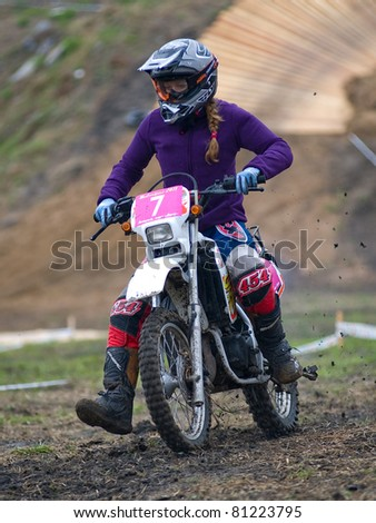 """KHABAROVSK RUSSIAN - MAY 21: Irina Greben in action at the first stage of the Khabarovsk enduro """"KHABARIGENS 2011 May 21, 2011 in Khabarovsk, Russia - stock photo"""