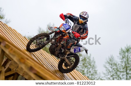 """KHABAROVSK RUSSIAN - MAY 21: motorcycle racer in action at the first stage of the Khabarovsk enduro """"KHABARIGENS 2011 May 21, 2011 in Khabarovsk, Russia - stock photo"""