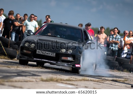 """KHABAROVSK RUSSIAN - SEPTEMBER 10: Tsyganov  Kirill in action at Round 5 competition """"DRAG RACING in Khabarovsk"""".  on September 10, 2010 in Khabarovsk Russia - stock photo"""