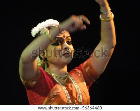 KHAJURAHO, INDIA - NOV 4 : Indian dancer performs classical dance on Nov 4, 2009 in Khajuraho, India. - stock photo