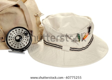 khaki hat with fly fishing equipment - stock photo
