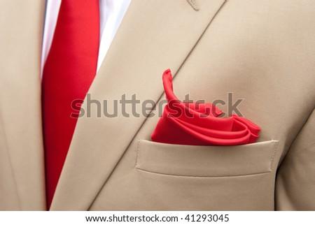 Khaki Suit with red handkerchief - stock photo