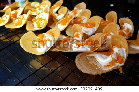 Khanom Beaung Thai or a kind of filled pancake Thai food or Thai Style Crisp Tart on tray, Thailand - (Selective focus)