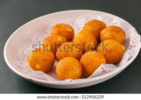 Khanom kai nok krata or deep-fried sweet potato balls - stock photo