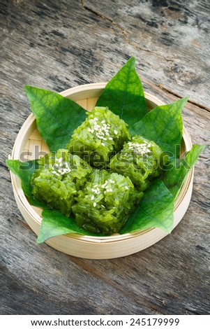 khao neaw Kaew, green gelatinous rice, Thai dessert - stock photo