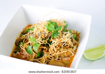 Khao soy a famous northern Thai food. A noodle dish in a yellow curry with chicken - stock photo