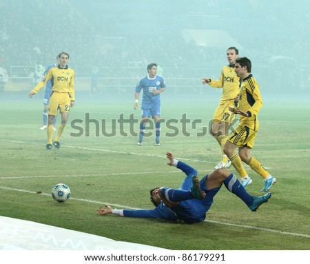 KHARKIV, UA - MARCH 13: FC Dnipro Dnipropetrovsk MF Yevhen Konoplianka downed during football match vs. FC Metalist Kharkiv, March 13, 2011 in Kharkov, Ukraine - stock photo