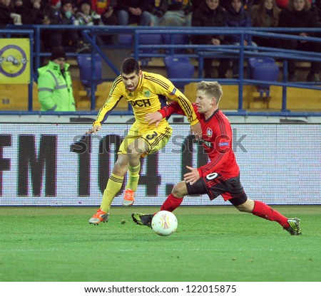 KHARKIV, UA - NOVEMBER 22: Bayer Leverkusen MF Kolja Pusch (R) in action during UEFA Europa League Group stage football match vs. FC Metalist Kharkiv, November 22, 2012 in Kharkiv, Ukraine