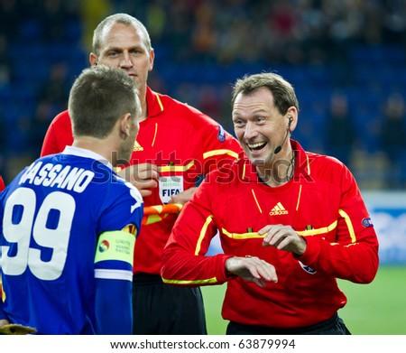 KHARKIV, UA - OCTOBER 21: Referee Florian Meyer (R) coin toss at starts of UEFA Europe League football match Metalist Kharkiv vs. Sampdoria Genoa, October 21, 2010 in Kharkov, Ukraine - stock photo
