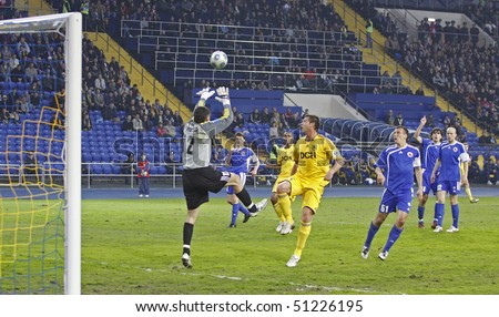 KHARKIV, UKRAINE - APRIL 15: FC Ilyichevets (Mariupol) goalkeeper Oleg Ostapenko (L) in action during soccer match vs. FC Metalist (Kharkiv), April 15, 2010 in Kharkov, Ukraine - stock photo