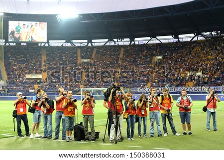 KHARKIV, UKRAINE -AUG 07:Ukrainian Media Stuff during the UEFA Champions League soccer match METALIST vs PAOK at Metalist Arena on August 07,2013 in Kharkiv, Ukraine. - stock photo