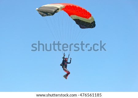 Kharkiv, Ukraine - August 20, 2016: Skydiver flying on colorful parachute at the airfield Korotych, Kharkov region, Ukraine on August 20, 2016