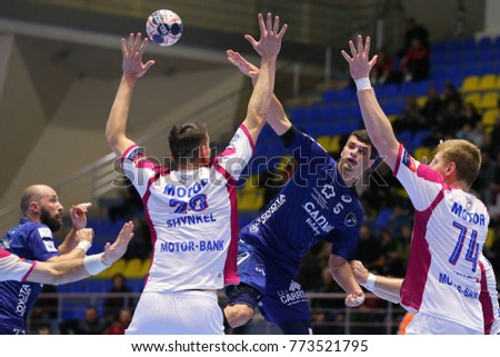 KHARKIV, UKRAINE - DECEMBER 03, 2017: VILLEMINOT Kyllian portrait. Passes the ball through opponents hands. EHF Men's Champions League. HC Motor Zaporozhye - Montpellier HB