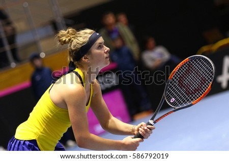 KHARKIV, UKRAINE - FEBRUARY 11, 2017: Elina SVITOLINA of Ukraine in action during BNP Paribas FedCup World Group II 1st Round tennis game against Ashleigh BARTY of Australia in Kharkiv, Ukraine