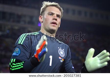 KHARKIV, UKRAINE - JUNE 13, 2012: Goalkeeper Manuel Neuer of Germany in action during UEFA EURO 2012 game against Netherlands on Kharkiv Arena - stock photo