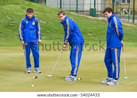 KHARKIV, UKRAINE - MAY 22: Ukrainian National football team players during visit to Superior golf club. Marko Devic(C) , May 22, 2010 in Kharkov, Ukraine