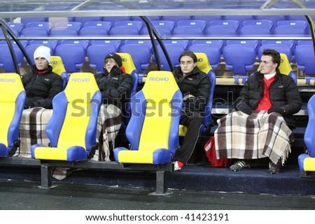 KHARKIV, UKRAINE - NOVEMBER 21: Reserve players sit down before FC Metallist (Kharkov) - FC Zarya (Lugansk) (2:0). Ukrainian Prime League Cup soccer match, November 21, 2009 in Kharkov, Ukraine - stock photo