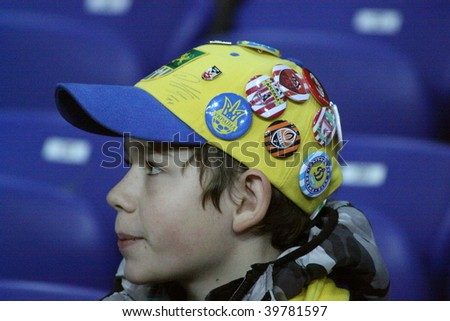 KHARKIV, UKRAINE - OCTOBER 25: An unidentified fan with a multi-pin cap attends a Ukrainian Prime League Cup soccer match between FC Metallist (Kharkov) vs FC Vorskla (Poltava) on October 25, 2009 in Kharkov, Ukraine