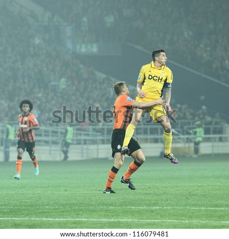 KHARKIV, UKRAINE - OCTOBER 7: FC Metalist Kharkiv MF Jose Ernesto Sosa (R) in action during football match vs FC Shakhtar Donetsk, October 7, 2012 in Kharkov, Ukraine