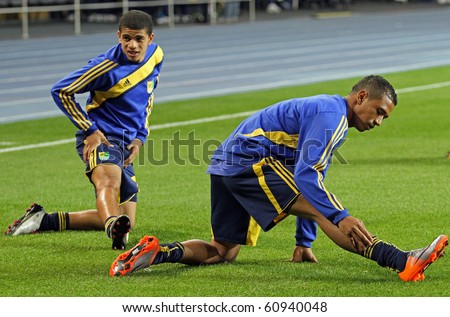 KHARKIV, UKRAINE - SEPTEMBER 12: FC Metalist Kharkiv DF Vinicius Fininho (R) warming-up before football match vs. FC Zorya Luhansk, September 12, 2010 in Kharkov, Ukraine