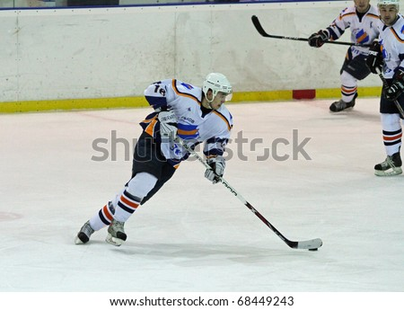 KHARKOV, UA - NOVEMBER 30: Igor Krivonos, No. 16 (L), in action during HC Kharkov vs. Donbass (5:8) ice hockey match on November 30, 2010 in Kharkov, Ukraine - stock photo