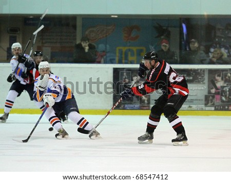 KHARKOV, UA - NOVEMBER 30: Unidentified players in action during HC Kharkov vs. Donbass (5:8) ice hockey match, November 30, 2010 in Kharkov, Ukraine