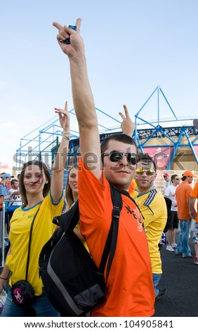KHARKOV, UKRAINE - JUNE 9: Ukrainian supporters in Kharkov, Ukraine on June 9, 2012. Kharkov and 7 other venues in Ukraine and Poland are currently hosting UEFA EURO Championship in 2012 - stock photo