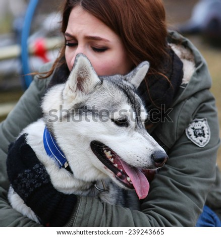 Kharkov, UKRAINE - November 15, 2014: Julia Lebedinskaya during one dog Bikejoring Women's 3100 m at Sled dogs dry land race Autumn Cup - 2014 - stock photo