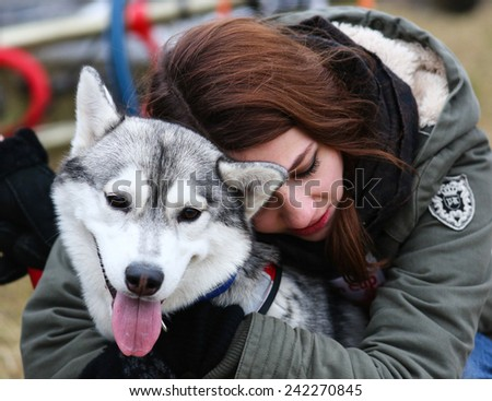 Kharkov, UKRAINE - November 15, 2014: Julia Lebedinskaya during one dog Bikejoring Women's 3100 m at Sled dogs dry land race Autumn Cup - 2014