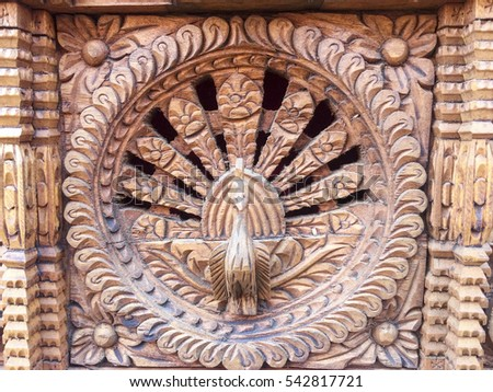Khatmandu, Nepal-Dec 16, 2016:Ancient woods and stone carving with Hindus symbol in Bhaktapur, Place of devotees. Also known as Bhadgaon or Khwopa, an ancient Newar city in Kathmandu Valley, Nepal
