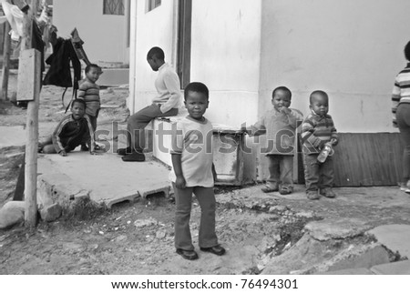 KHAYELITSHA, CAPE TOWN - MAY 22 : A unidentified group of young children play on a street of Khayelitsha township, on May 22, 2007, Cape Town, South Africa - stock photo