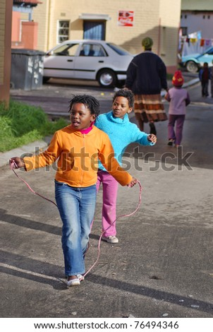 KHAYELITSHA, CAPE TOWN - MAY 22 : A unidentified group of young girls play on a street of Khayelitsha township, on May 22, 2007, Cape Town, South Africa - stock photo