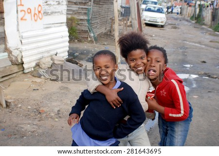 KHAYELITSHA, CAPE TOWN - MAY 22 : A unidentified group of young teenager dance on a street of Khayelitsha township, the name is Xhosa for New Home on May 22, 2007, Cape Town, South Africa - stock photo