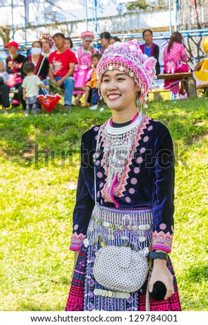 KHEK NOI, PHETCHABUN,THAILAND - DECEMBER 16: Unidentified traditionally dressed Hmong hill tribe girl play a ball in Hmong new year festival on December 16, 2012 in Phetchabun, Thailand. - stock photo