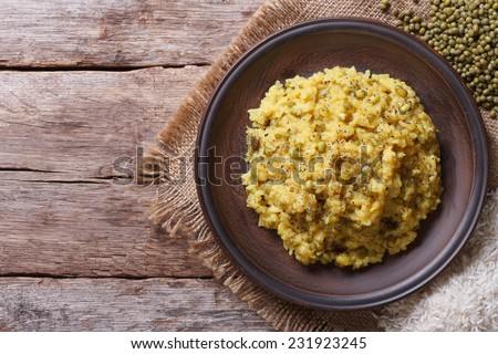 Khichdi: rice and mung bean and spices. Close-up view from above. Horizontal  - stock photo